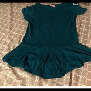 Teal shirt with ruffles around the bottom